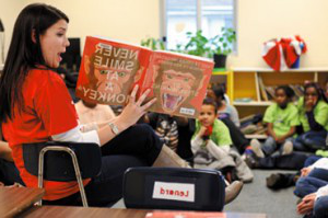 Image iSchool student reading to elementary students